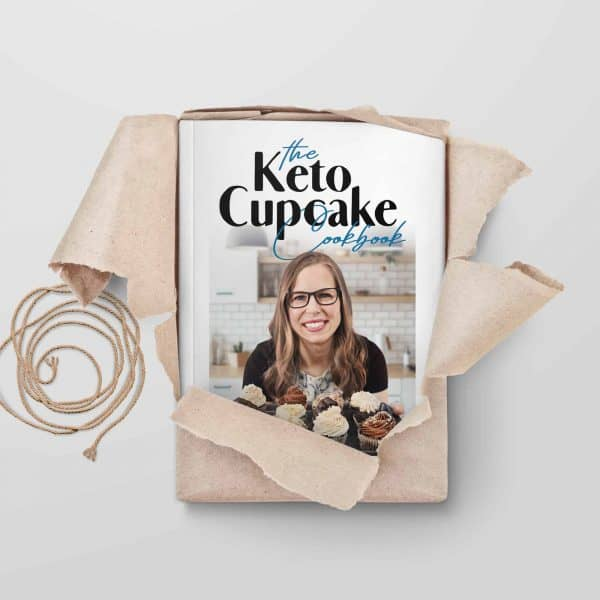 keto cucpake cookbook being unwrapped from paper packaging